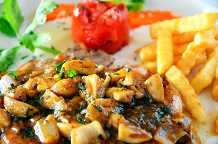 Delicious beef steak with mushrooms  photo