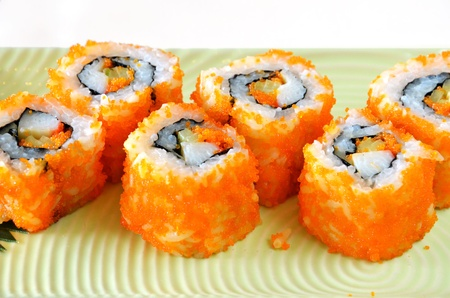 egg imitation crabmeat cucumber tuna and salmon roll sushi photo