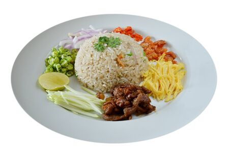Mixed cooked rice with shrimp paste sauce and fresh vegetable photo