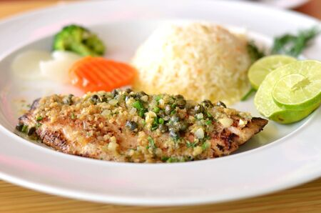 roasted fish served with fried rice photo