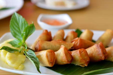 Chinese spring rolls with vegetable and pineapple photo