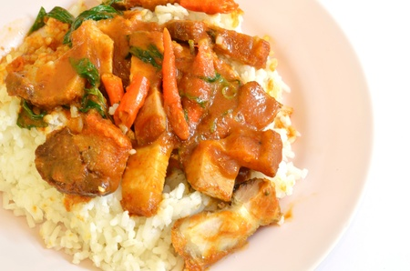 Stir fried crispy pork with red curry paste and rice photo