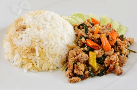 Rice and  minced pork fried with chilli pepper and  sweet basil  photo