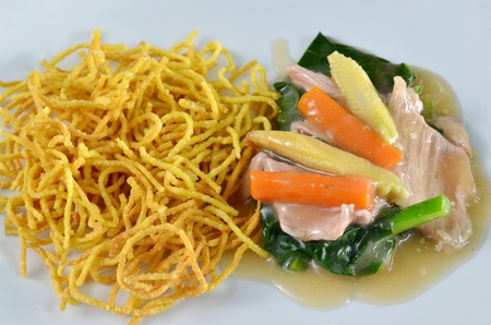 crispy yellow noodle with in a creamy gravy sauce Stock Photo - 11681965