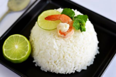 steamed rice served with fresh lemon and shrimp , waiting food photo