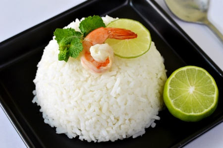steamed rice served with fresh lemon and shrimp , waiting food