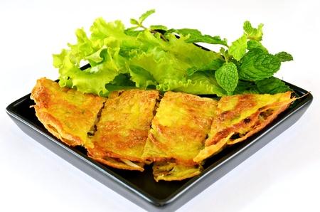 Vietnamese stuffed crispy omelette served with fresh vegetable photo