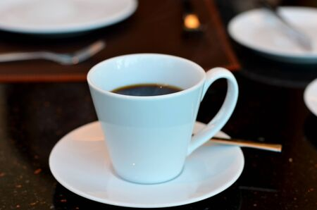 Cup of black coffee on the  table photo
