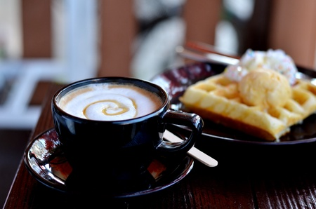 hot coffee served with waffle and icecream photo