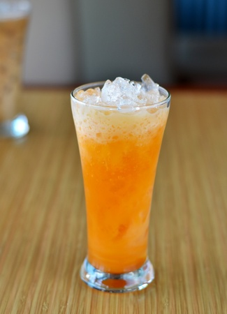 ice orange tea with fresh milk in glass photo