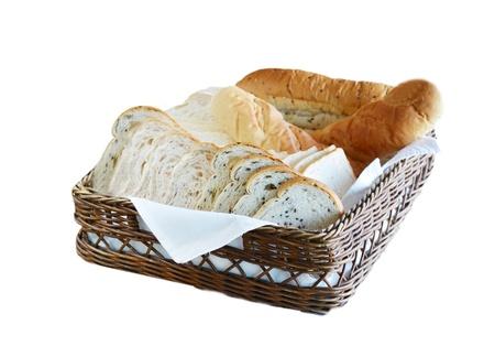 Arrangement of bread in basket on table photo