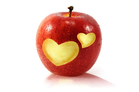 fresh red apple with heart shape photo