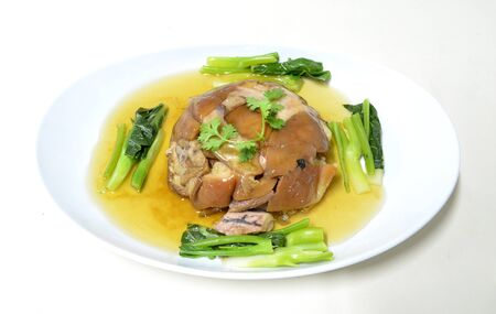 stewed pork knuckle with kale , chinese cuisine photo