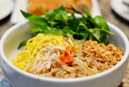 fermented rice vermicelli served with curry and vegetable