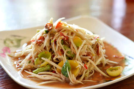 thai papaya salad hot and spicy , mixed from variety of vegetable photo