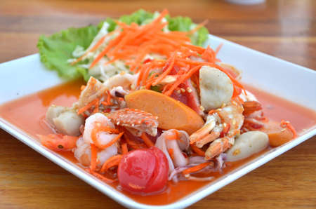 Thai cuisine ,  spicy seafood salad on wooden table photo