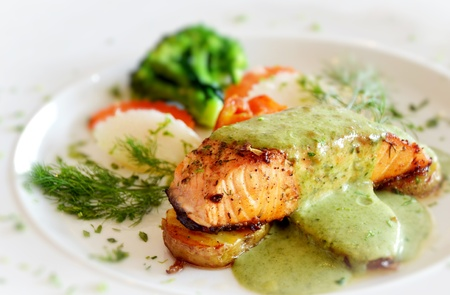roasted salmon served with green sauce Imagens