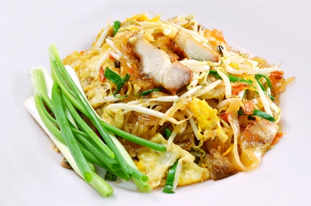 favorite Thai cuisine , Thai food Pad thai , Stir fry noodles with crispy pork Stock Photo - 12911462