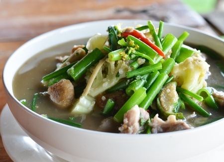 sour grass: A savoury thick soup made from spices and vegetables