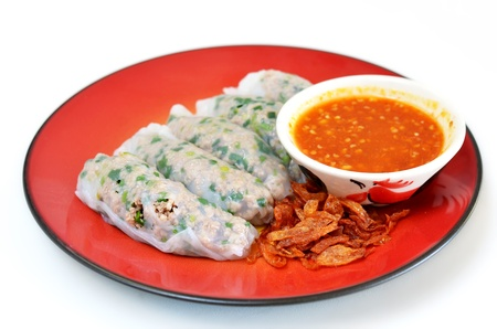 Vietnamese rice noodle rolls with a filling of pork sliced and vegetable ,  fried onion served with spicy sauce