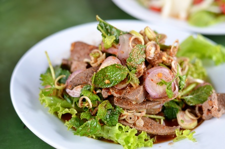 mixed  fresh vegetable and steamed liver , Thai spicy salad