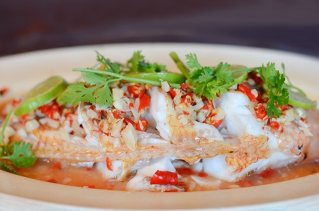 Steamed  fish with chili and  lemon ,  hot and spicy