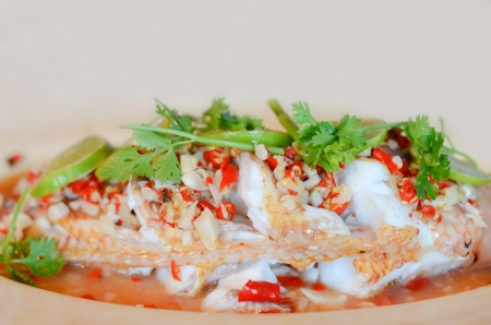 Steamed  fish with   lemon and chili ,  hot and spicy Stock Photo