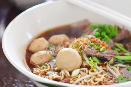 close-up of instant noodles and  meatball  with chopsticks , asian noodle photo
