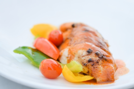 grilled chicken fillet served with fresh vegetable  photo