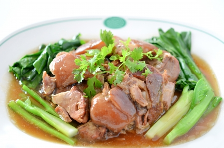 stewed pork knuckle with kale inside , chinese cuisine photo