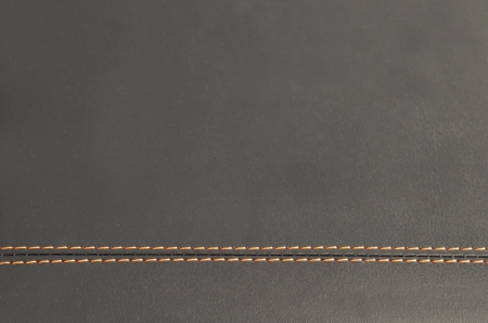 horizontal stitched leather background or texture