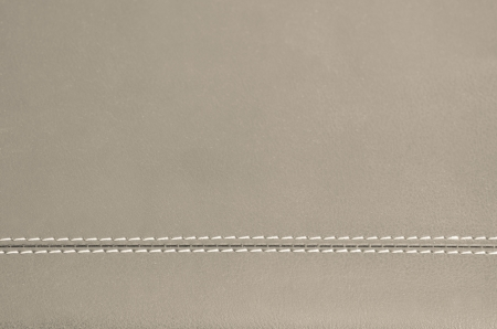beige  horizontal stitched leather background   Imagens