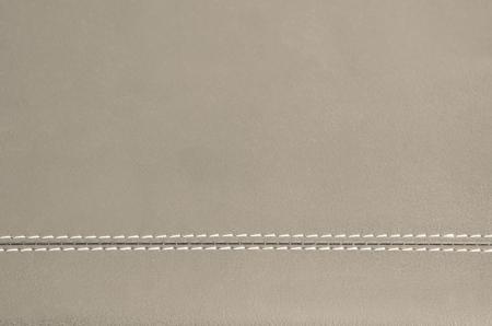 beige  horizontal stitched leather background   Stock Photo
