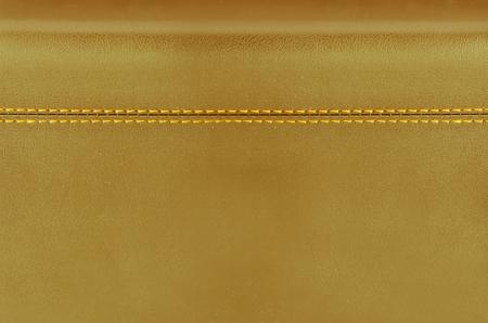 golden  horizontal stitched leather background   photo
