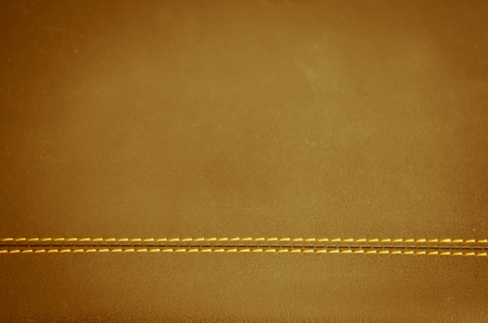 brown   horizontal stitched leather background   photo