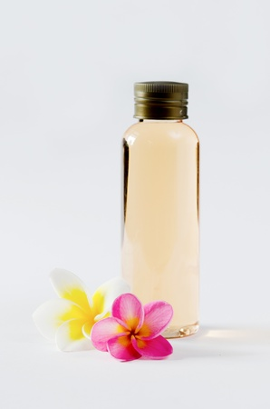bottles and  fresh plumeria on white background Stock Photo
