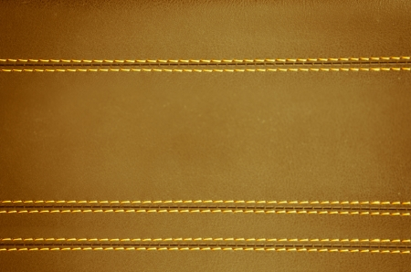 brown  horizontal stitched leather background, art textures photo
