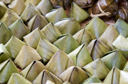 Sweet sticky rice in banana leaf package photo