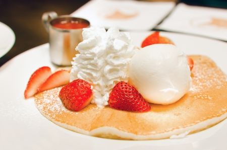 whipping: pancakes with strawberries and whipping cream , ice cream   Stock Photo