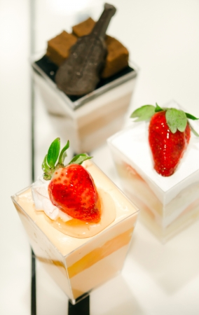 cheese cake with  strawberries,  decorated with fresh strawberries and chocolate , served in a bowl with a small photo
