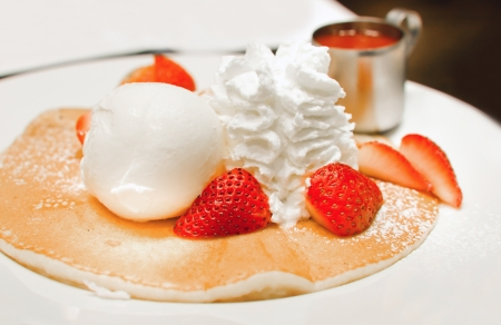 pancakes with strawberries and whipping cream , ice cream . Stock Photo - 15975987