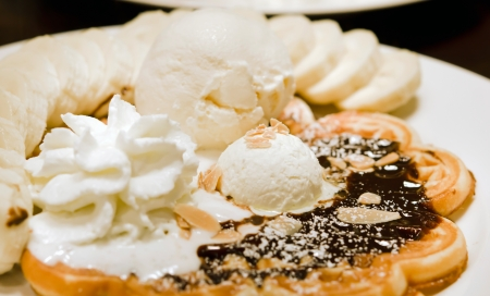 whipping: vanilla ice cream waffle with bananas and whipping cream Stock Photo