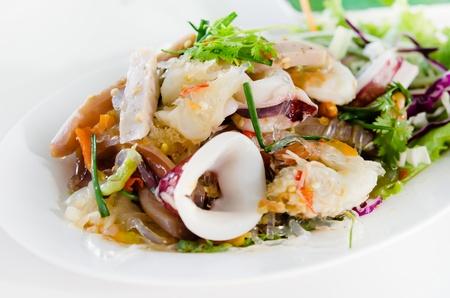 spicy mix seafood salad , Thai style food .