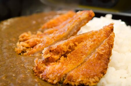 Japanese breaded deep fried pork cutlet  tonkatsu  served with steamed rice and curry sauce