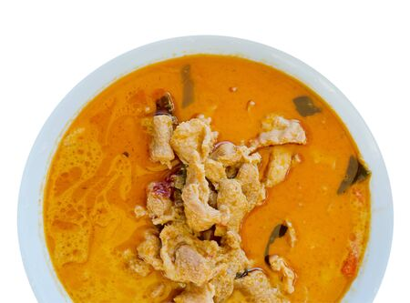 top view pork in ground peanut-coconut cream curry  on white  background photo
