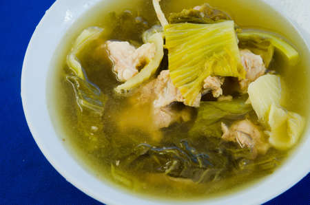 clear soup with  pork and pickled  vegetables photo