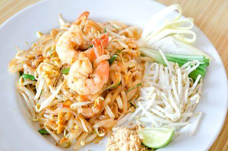 Stir fry noodles with shrimp , egg  and fresh vegetable , Favorite Thai  food photo