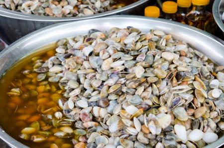 vittatus: pickled  banded wedge shell in market Stock Photo