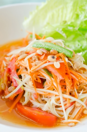 thai papaya salad with  fresh lettuce photo