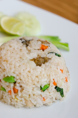 Mixed cooked rice with fried fish , sauce and  vegetable photo